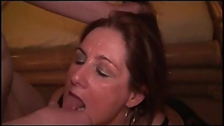 Cuckold MILF sucking 2 guys while sissy husband watches