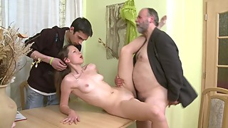 A young Cuckold and his nice and young Girlfriend fuck with an Old Man.